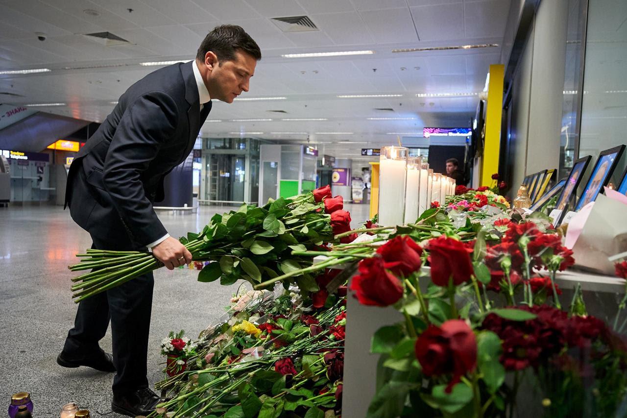 Ukrainian President Volodymyr Zelenskiy lays flowers to commemorate victims of the Ukraine International Airlines plane crash, at a memorial in Boryspil International airport outside Kyiv, Ukraine, on Jan. 9, 2020.