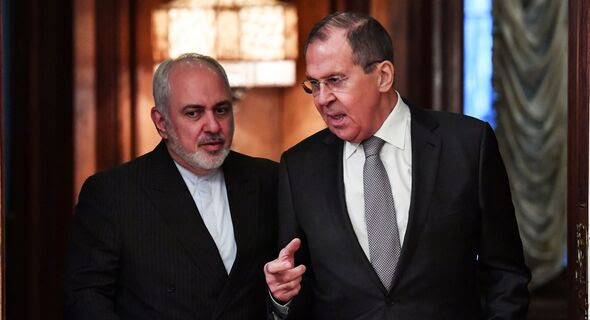 Russian Foreign Minister Sergey Lavrov (R) meets with Iranian Foreign Minister Mohammad Javad Zarif in Moscow on Dec. 30, 2019. The two met again in Tehran, Iran, on April 13, 2021.