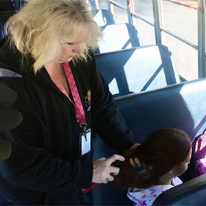 Bus driver fixes students' hair on the school bus