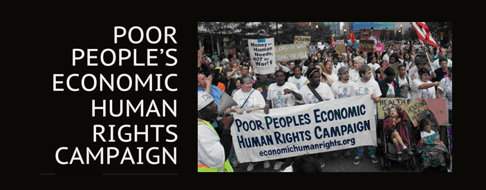 Large group of protesters with a group of people in the foreground holding a sign for Poor Peoples Economic Human Rights Campaign.