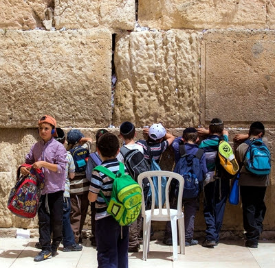 Jewish boys pray at the Western (Wailing) Wall.
