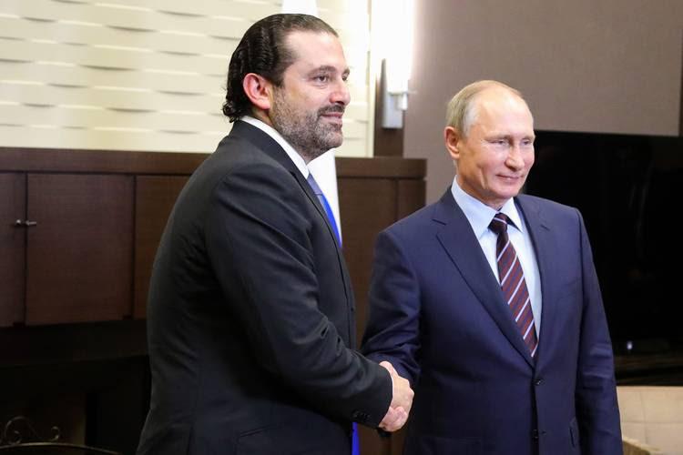 Russian President Vladimir Putin shakes hands with Lebanese Prime Minister Saad Hariri during a meeting yesterday in Sochi. (Michael Klimentyev/Sputnik/AFP/Getty Images)
