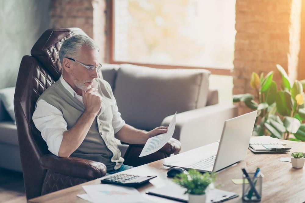 Older gentleman looking over paperwork