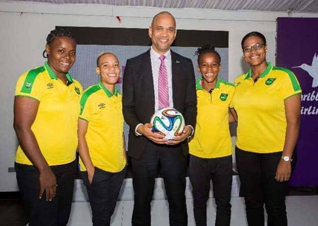 Caribbean Airlines CEO, Garvin Medera and members of the Senior Reggae Girlz football team.