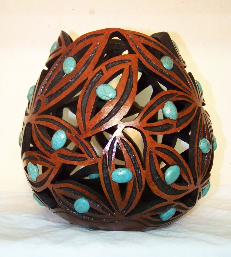 Gourd set with turquoise cabochons made by Susan K. Burton.