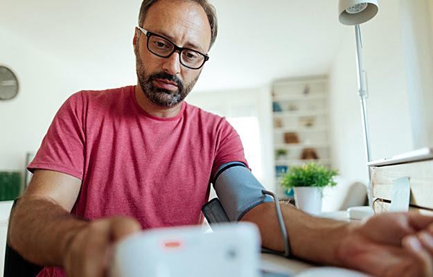 A man checking his blood pressure.