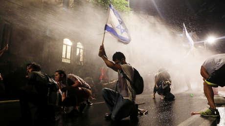VIDEO, FOTOS: Manifestantes chocan con la Policía en Jerusalén y Tel Aviv durante protestas contra Netanyahu