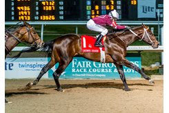 Midnight Bourbon wins the Lecomte Stakes at Fair Grounds Race Course