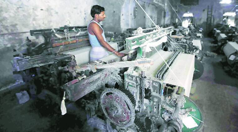 A worker at a power loom (Source: Express photo)