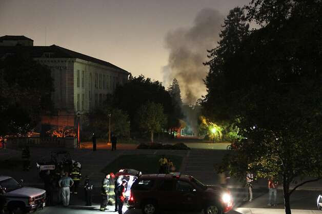 This image provided by The Daily Californian shows emergency crews at the scene of an explosion on the University of California Berkeley campus on Monday, Sept. 30, 2013 in Berkeley, Calif.  At least one person was hospitalized and a mandatory evacuation was ordered after the explosion followed a power outage across campus.  Fire crews freed about 20 people trapped in dormitory elevators across campus as a result of the outage, said UC Berkeley spokesman Dan Mogulof. (AP Photo/The Daily Californian, Alex Turney) MANDATORY CREDIT: THE DAILY CALIFORNIAN Photo: Alex Turney, Associated Press