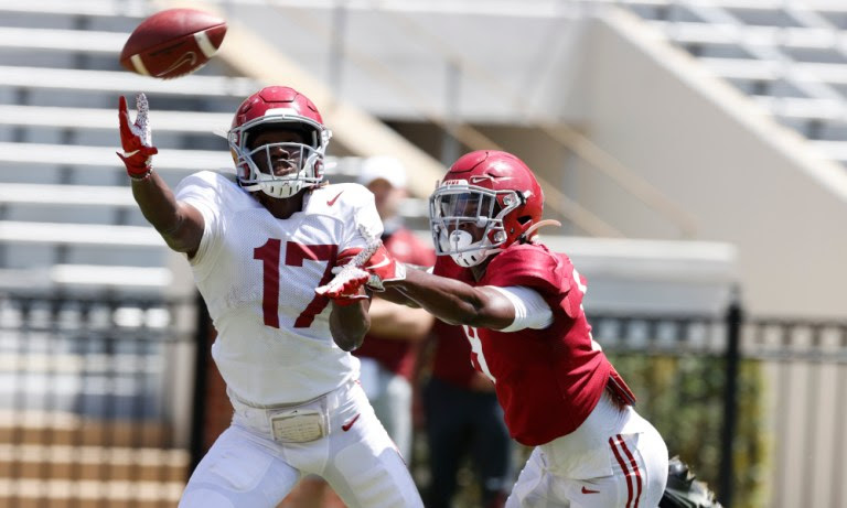 Agiye Hall (No. 17) trying to make the catch in Alabama's second scrimmage
