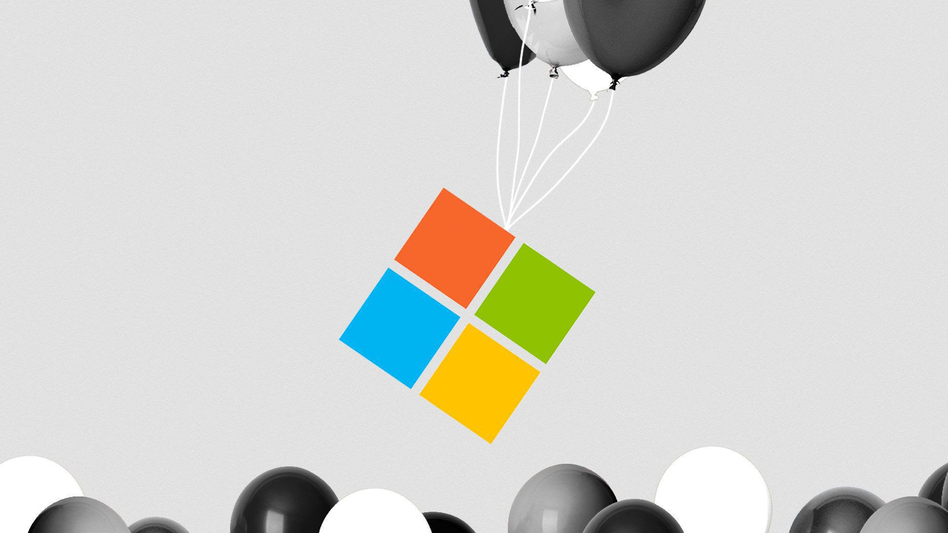 An image of the Microsoft logo being lifted by balloons.