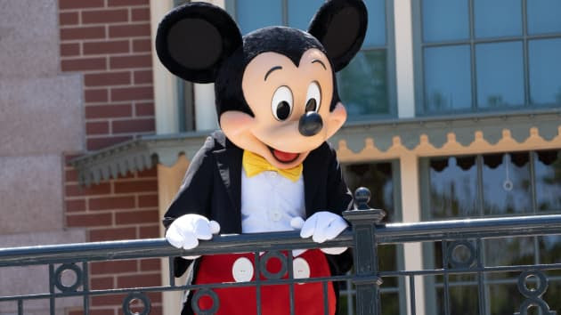 Mickey Mouse stands in front of a building