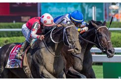 Midnight Bisou (outside) edges Elate to win the Personal Ensign Stakes at Saratoga Race Course