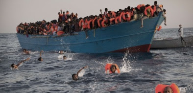 Migrants, most of them from Eritrea, jump into the water from a crowded wooden boat as they are helped by members of an NGO during a rescue operation at the Mediterranean sea, about 13 miles north of Sabratha, Libya, Monday, Aug. 29, 2016. Thousands of migrants and refugees were rescued Monday morning from more than 20 boats by members of Proactiva Open Arms NGO before transferring them to the Italian cost guards and others NGO vessels operating at the zone.(AP Photo/Emilio Morenatti)/EM101/16242365088139/1608291331