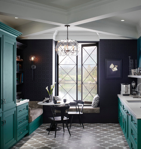 This cal, kitchen is decorated in white and sea green.