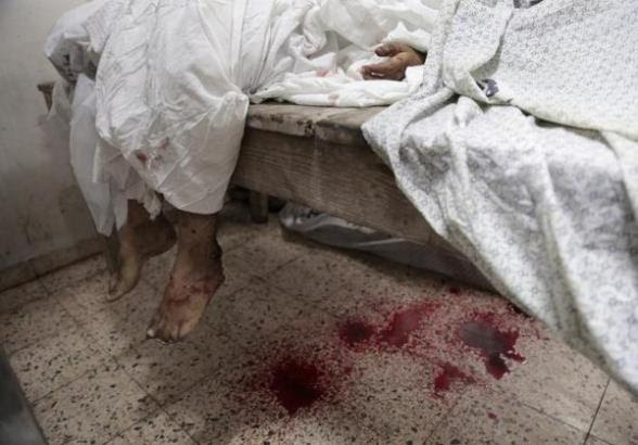 Horrible killing in #Gaza. Gazan corpses lied everywhere = Photo via @m_househ