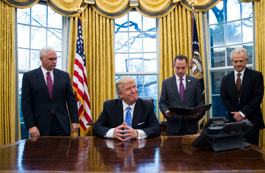 President Trump prepared to sign three presidential memorandums in the Oval Office on Monday.