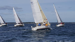 J/30s sailing off starting line on Buzzards Bay