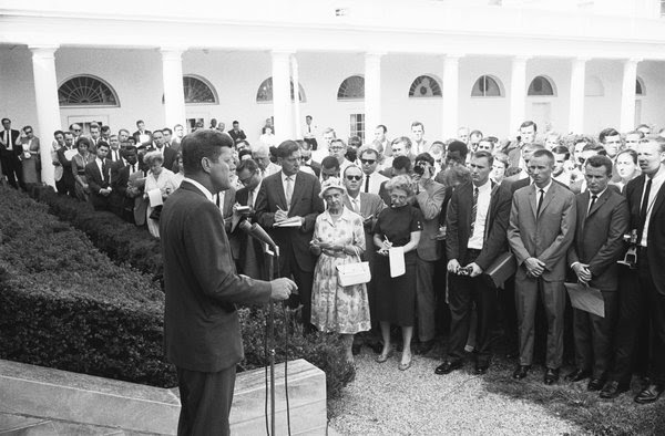 President John F. Kennedy addressed journalists and members of the Peace Corps on Aug. 28, 1961. Kennedy assigned the volunteers their first mission overseas.