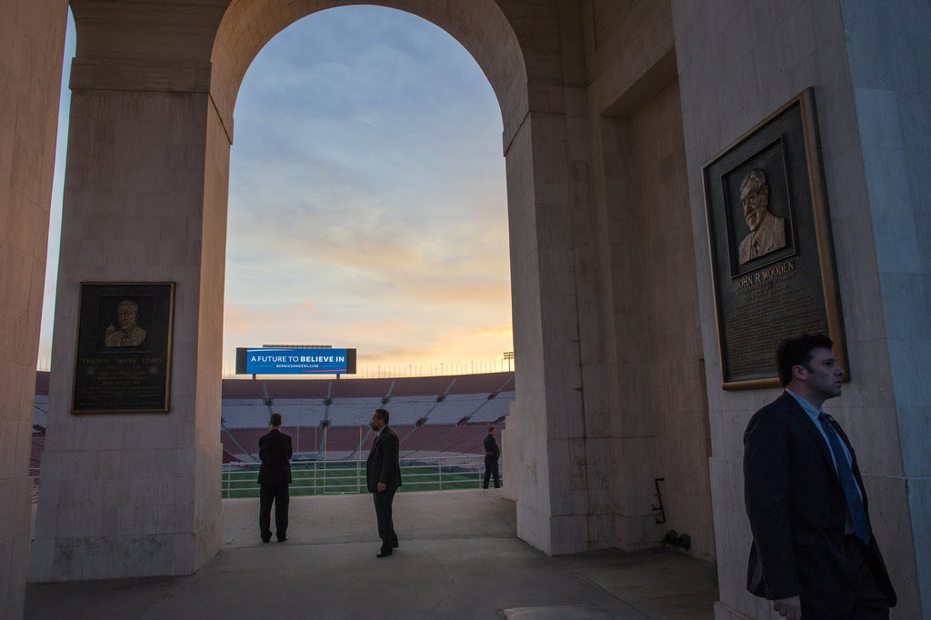 Secret Service agents before Bernie Sanders spoke at a rally at the Los Angeles Memorial Coliseum Olympic Plaza on Saturday.