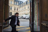 In May, French tax authorities raided Google's headquarters in Paris. A guard shuts the gate to the offices.