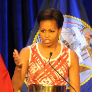 1280px-US_Navy_110407-N-4930E-181_First_Lady_Michelle_Obama_talks_about_the_individual_accomplishments_of_each_recipient_for_the