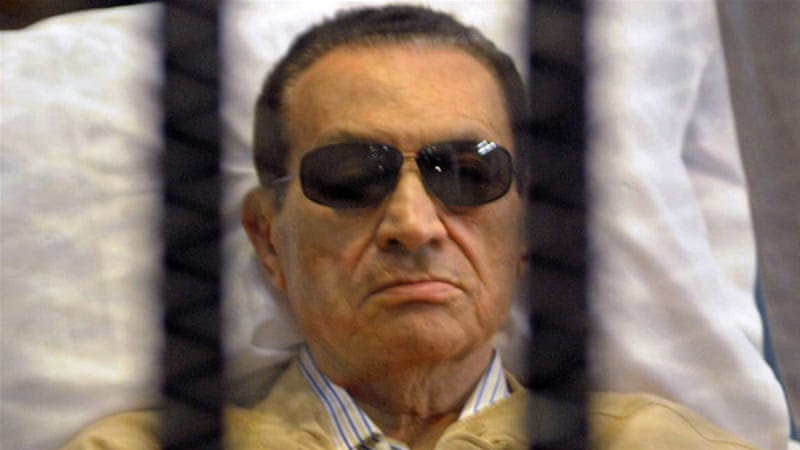 Ousted Egyptian president Hosni Mubarak sits inside a cage in a courtroom during his verdict hearing in Cairo on June 2, 2012 [AFP]